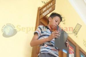 Michael Juanda, saat melaporkan kejadian yang menimpanya di UPPA Sat Reskrim Polres Tuban