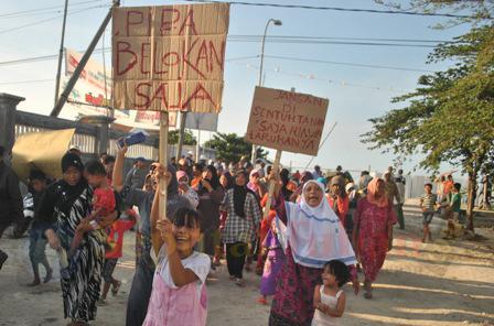 Aksi Protes Pipanisasi MCL Palang