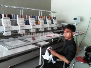 MENGUNTUNGKAN : Mesin bordir otomatis mampu memproduksi dengan kwalitas terbaik dalam jumlah banyak